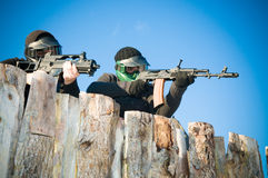 Airsoft players shooting Stock Photo