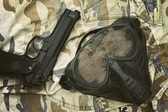 Airsoft protection mask, Terrorist mask and 9mm pistol. Royalty Free Stock Photo