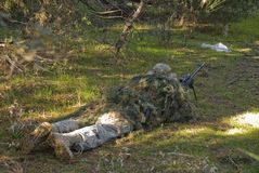 Airsoft Sniper. With ghillie waiting for target in an Airsoft party Royalty Free Stock Images