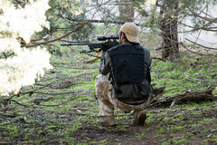 Airsoft sniper shooting Royalty Free Stock Images