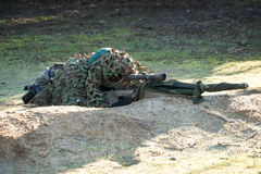 Airsoft sniper shooting Stock Photography