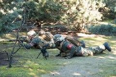 Airsoft soldatskytte Fotografering för Bildbyråer