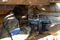 Airsoft soldier shooting Royalty Free Stock Images