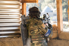 Airsoft soldier shooting Royalty Free Stock Photo