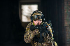Airsoft strikeball player in military soilder Royalty Free Stock Image