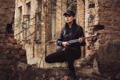 Airsoft woman soldier with a rifle playing strikeball In old building royalty free stock photography