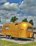 Airstream Stellas Golden Vintage Camper. Vintage travel trailer Wally and Stella Byam restored gold Camping coach on display Airstream HQ Jackson Center, Ohio royalty free stock photography