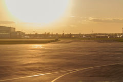 Airstrip at the airport. Empty runway at the airport in anticipation of landing the plane. Sunset. Concept travel Stock Photo