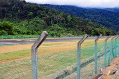Airstrip in the middle of the jungle. stock photo