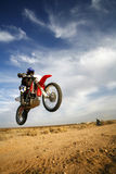 Airtime. This dirt bike rider launches off a jump in California City desert Stock Image