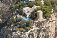 Airview from Alicante coast. House and historical tower on cliff stock image