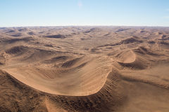Airwiev of the dunes of Sossusvlei, Namibia. Airwiew of the dunes and sourounding region of the Sossusvlei. Here you find the worlds highes sand dunes. Located Stock Photos