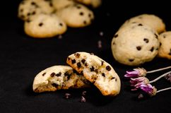 Homemade cookies with chocolate drops filling on a black background royalty free stock photo
