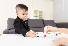 Aisa baby boy drawing Stock Images