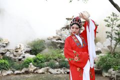 Aisa Chinese opera female Peking Beijing Opera Pavilion garden outdoor china traditional costume bride role drama play stock photography