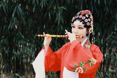 Aisa Chinese woman Peking Beijing Opera Costumes dress garden China traditional drama perform ancient Bamboo flute instruments. Eastern Asian oriental stock photography