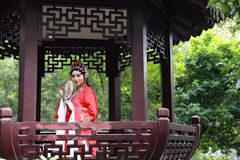 Aisa Chinese woman Peking Beijing Opera Costumes Pavilion garden China traditional role drama play royalty free stock image