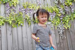 Aisa cute naughty lovely adorable child girl play with balloon have fun outdoor in summer park happy smile happiness childhood. A little Asian Chinese girl, have Stock Images