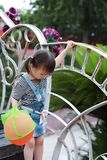 Aisa cute naughty lovely child girl play with balloon have fun outdoor in summer park happy smile happiness funny childhood. A little Asian Chinese girl, have Stock Photo