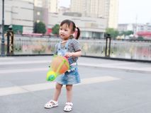 Aisa cute naughty lovely child girl play with balloon have fun outdoor in summer park happy smile happiness funny childhood. A little Asian Chinese girl, have Royalty Free Stock Photo
