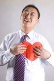 Aisa mens met rood hart Stock Afbeelding