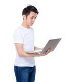 Aisan man look at laptop Stock Photography