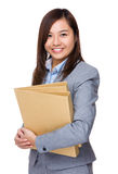 Aisan Young Businesswoman hold with folder Royalty Free Stock Images