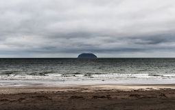 Aisla Craig. Ailsa Craig on a winters day. The top is lost in the clouds and the sky is heavy royalty free stock photo