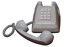 Aislado en blanco levantó el teléfono modelo viejo del escritorio con la trayectoria de recortes Imagen de archivo libre de regalías