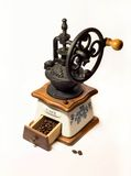 Aislante de la amoladora de café del vintage en el fondo blanco Fotografía de archivo libre de regalías
