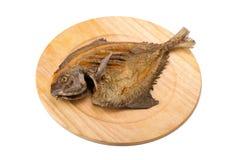 Aislante de la fritada del pompano en el fondo blanco Imagen de archivo libre de regalías