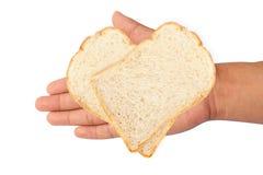 aislante del pan blanco a mano en el fondo blanco Fotografía de archivo