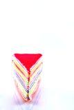 Aislante dulce colorido de la torta del crespón en el fondo blanco Imagen de archivo libre de regalías