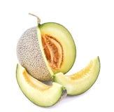Aislante maduro del melón del cantalupo en un fondo y un x28 blancos; PA del recortes Foto de archivo