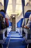 Aisle in an airplane. Interior of an airplane with passengers Royalty Free Stock Photos