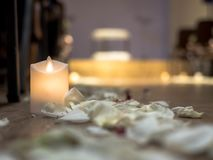 Aisle in the hall with candles with white petals on the floor in the wedding ceremony.  stock photo