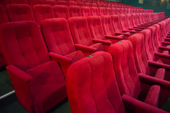 Aisle with rows of red seats Royalty Free Stock Photography