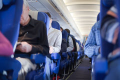 Aisle between seats in airplane cabin Royalty Free Stock Image