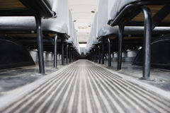 Aisle Between Seats In Bus. Aisle between seats in empty school bus royalty free stock photography