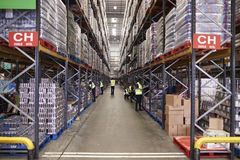 An aisle between storage units in a distribution warehouse royalty free stock photos