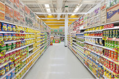 Aisle view of a Tesco Lotus supermarket. Royalty Free Stock Photo