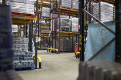 Aisles between storage racks in a distribution warehouse Stock Photo