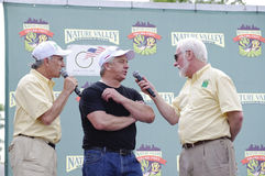 Aisner Roake and LeMond at Stillwater Criterium. STILLWATER, MN - June 19: Race announcers Michael Aisner and Jeff Roake speak with Greg LeMond before kicking stock images