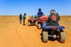 Ait Saoun, Morocco - February 23, 2016: Tourist on ATV in Ait Saoun Desert of Morocco wearing helmet for safety precautionary meas. Ure Royalty Free Stock Photography