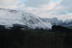 Aitzkorrigane Mendia, Orozko ( Basque Country ). Urigoiti with the Mount Aitzkorrigane in the background, Orozko, Bizkaia (Basque Country Royalty Free Stock Photo