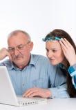 Aiutando con il nuovo computer Fotografie Stock