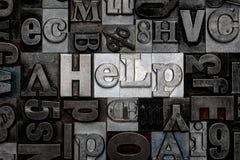 Aiuto dello scritto tipografico Immagine Stock