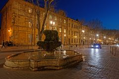 Fountain and Cours Mirabeau by night. AIX-EN-PROVENCE, FRANCE, April 6, 2018 : The Cours Mirabeau in Aix-en-Provence at night Stock Photo
