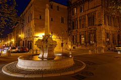 Fountain of Four Dolphins at night. AIX-EN-PROVENCE, FRANCE, April 6, 2018 : Place and Fountain of Four Dauphins, in the heart of the district Mazarin, at night Stock Images