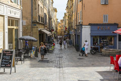 Aix en provence. France-August 9,2016:People strolling down the typical streets of Aix-en-Provence during a summer day Stock Photos